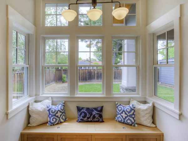 Double glazing will save you more money long term than secondary glazing.